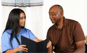 caregiver talking to elderly senior